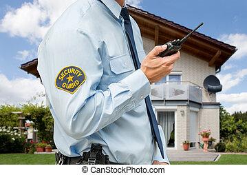 Security Guard Holding Walkie Talkie