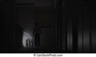 Security Guard makes a detour In Corridor Of The Building Using Flashlight. High-quality 4k footage