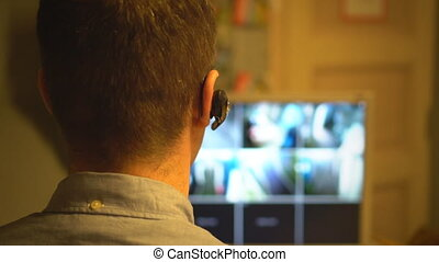 Security guard monitoring video in security room. From the...
