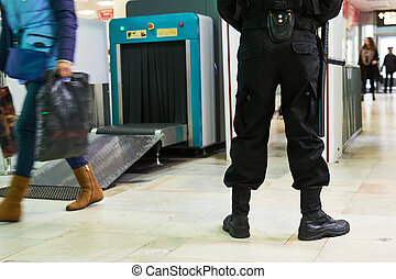 security guard near airoport x-ray scanner