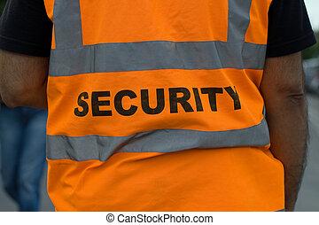 Security guard - Back of a security guard in orange uniform...