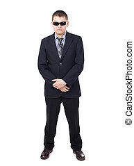 Security guard wearing a suit and sunglasses isolated on ...