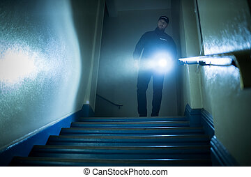 Security Guard With Flashlight