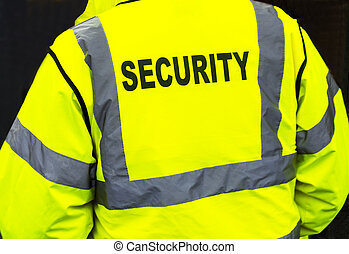 A closeup of a flourescent security jacket