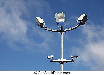 Security Lights Surveillance Camera - A close up of a pole...