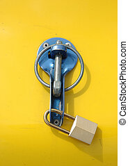 Security lock against yellow background