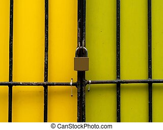 Security lock over yellow wall with metal frames
