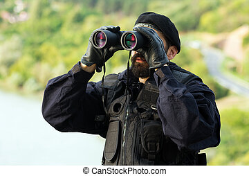 security man with binoculars