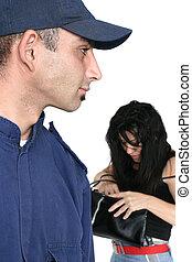 Security officer spots a thief rummaging through a stolen bag