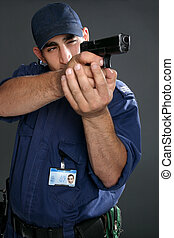 Security guard taking aim with gun. Please note: Badge photo is same person and was photographed by me. No extra release required.