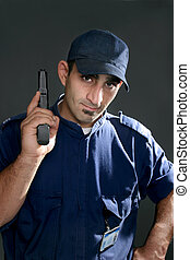 Security Officer - Watchful security officer in uniform, ...