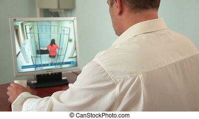 Security Staff at CCTV - Security guard in control room at...