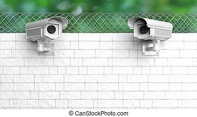 Security surveillance camera on white brick wall with chain-link fence