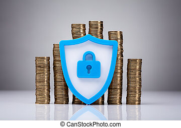 Security Symbol With Stack Of Coins - Security Symbol With...