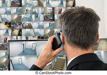 Security System Operator Looking At Cctv Footage