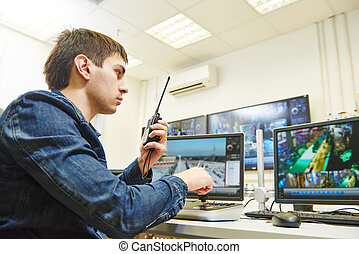 Security video surveillance - security guard watching video ...