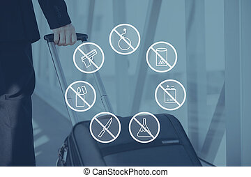 Security warnings. Digitally composed icon set over a picture of businessman pulling his suitcase in airport