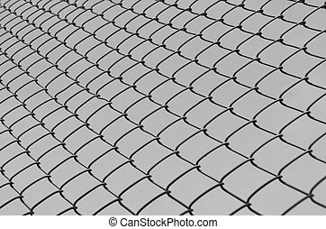 Security wire mesh fence against gray background