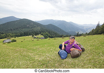 Sedentary tourist in mountains Carpathians.