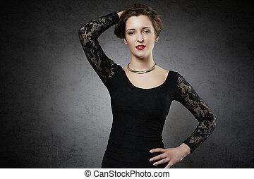 Seducing woman in black lace dress