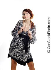 Seduction - A portrait of an elegant nice woman in a dress