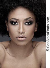Seductive African American woman with parted lips and bare...
