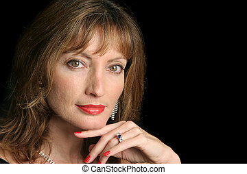 Seductive Beauty - A beautiful, seductive woman against a...