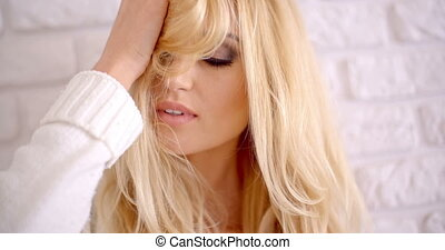 Seductive Blond Female Touching her Head