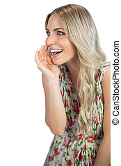 Seductive blonde wearing flowered dress telling secret