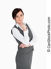 Seductive brunette businesswoman posing against white ...