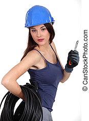 Seductive brunette electrician