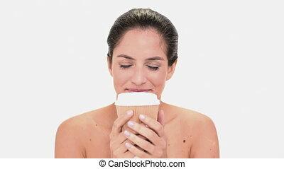 Seductive brunette woman enjoying coffee