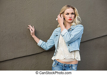 Seductive casual blonde wearing denim clothes posing...