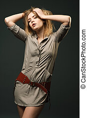 Seductive fashion portrait of young woman on dark background