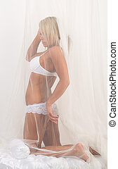 girl in lingerie on the bed with canopy