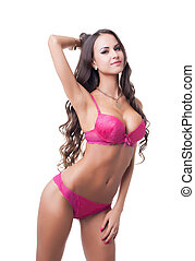Seductive girl posing in erotic fuchsia lingerie