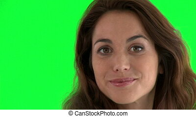 Seductive hispanic woman standing against a green screen