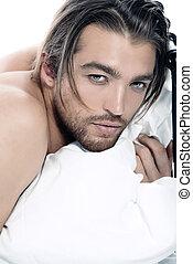seductive look - Close-up portrait of a handsome man lying ...