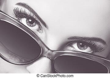 Seductive look over sunglasses