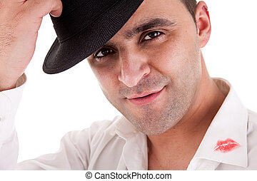 seductive man greeting with his hat, the shirt with lipstick mark