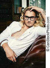 seductive man in glasses