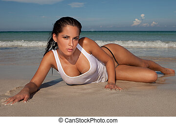 Seductive Model On Sandy Beach - Seductive model lying...