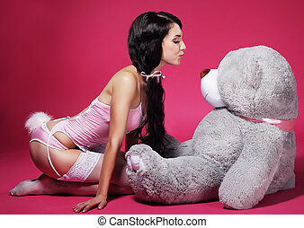 Seductive Playful Woman in Pink Lingerie with Teddy Bear