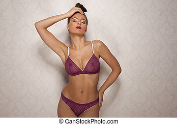 Seductive sexy woman in trendy purple lingerie