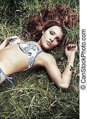 seductive - Shot of a sexy woman in bikini posing outdoor.