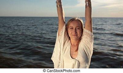Seductive woman enjoying beautiful sunset on beach