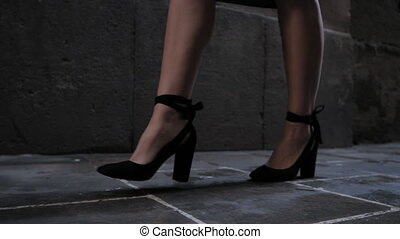 Seductive woman in beautiful dress with sexy legs walking in...