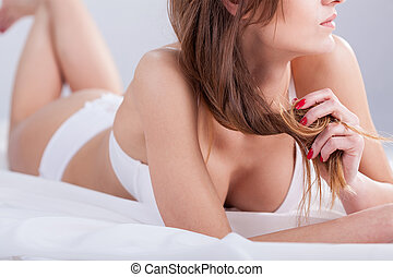 Seductive woman in bed