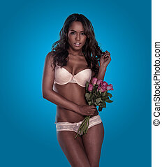 Seductive woman in lingerie with roses