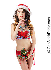 Seductive Woman in Santa Claus Stagy Costume showing Silence Sign. Hush!